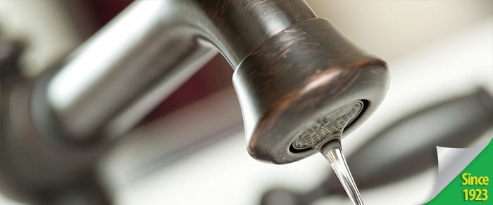close-up of a distressed faucet