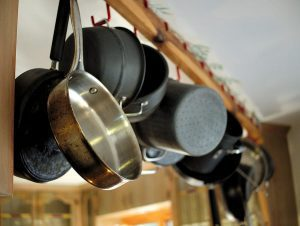 Cooking Pots And Pans Hanging In Kitchen.