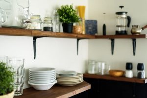 dishes on open shelves in the kitchen