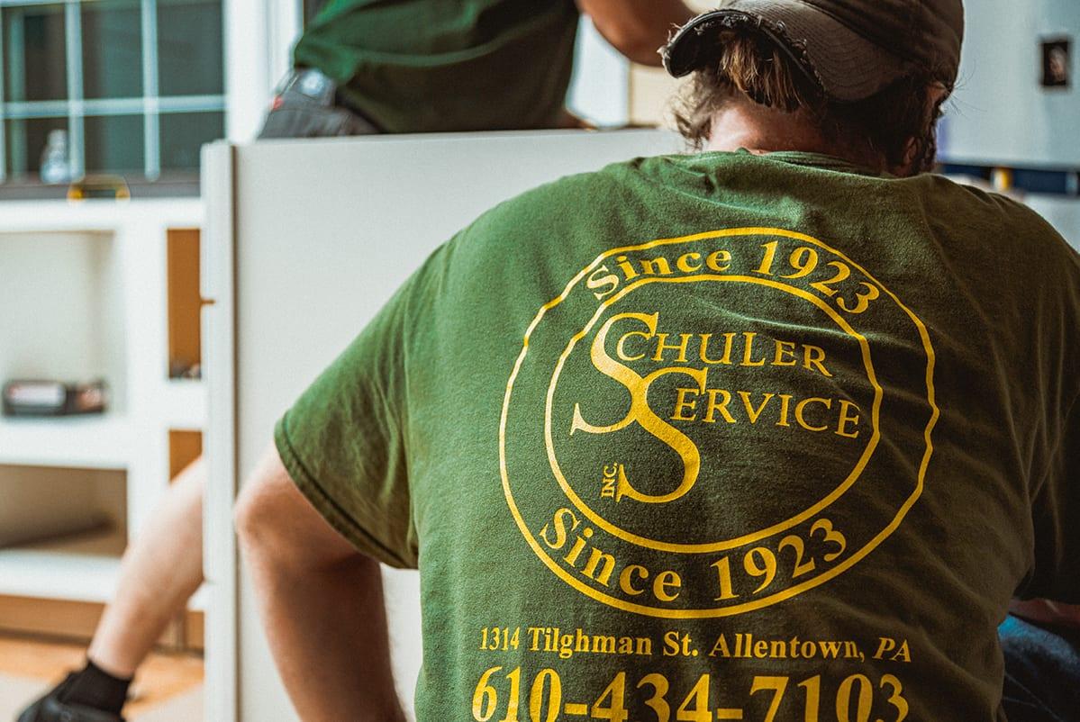 Technician wearing a schuler service branded tshirt